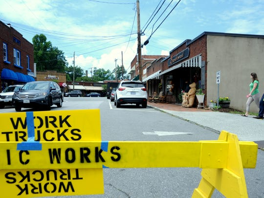 "A car turns onto Cherry Street on June 2 only to find that the majority of the road is closed while scenes from ""Three Billboards Outside Ebbing, Missouri"" are being filmed."