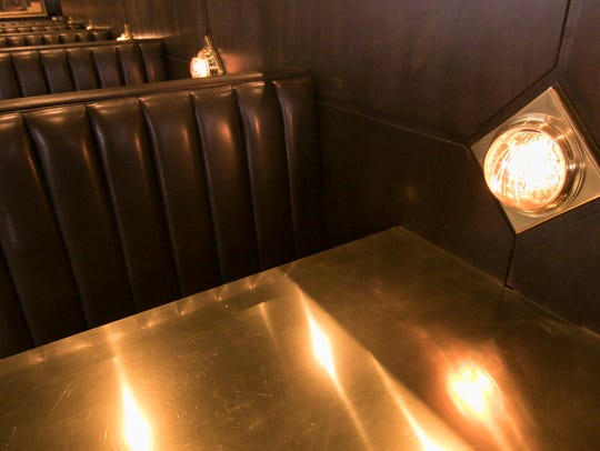 Seating and decor in Brighton's Bourbons, shown Thursday,