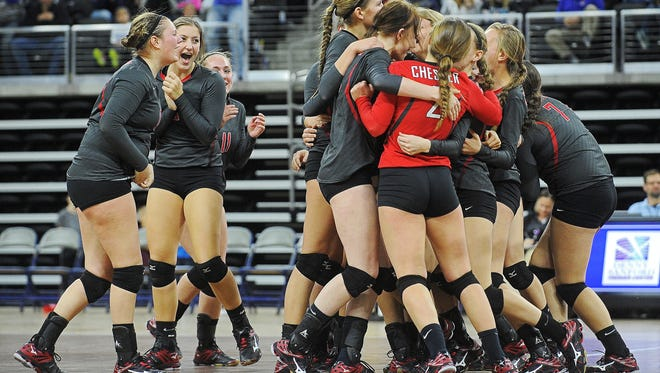 Chester Area players react after defeating Warner in the South Dakota State High School Class B championship volleyball match Saturday, Nov. 21, 2015, at the Denny Sanford Premier Center in Sioux Falls.