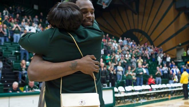 CSU basketball player Tiel Daniels hugs his mother, Rosalyn Roberts, following his senior day game Saturday at Moby Arena.