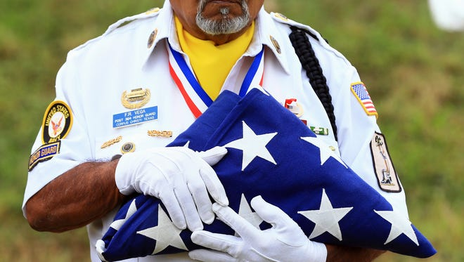 Feliciano Vega, a member of the American Legion Honor Guard, holds the American flag during the dedication of the Texas Historical Marker on Thursday, Nov. 10, 2016, at the Gold Star Court of Honor memorial at Spohn Park in Corpus Christi.