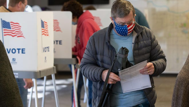 Shawnee County residents fill out their ballots Friday morning at the election office, 3420 S.W. Van Buren.