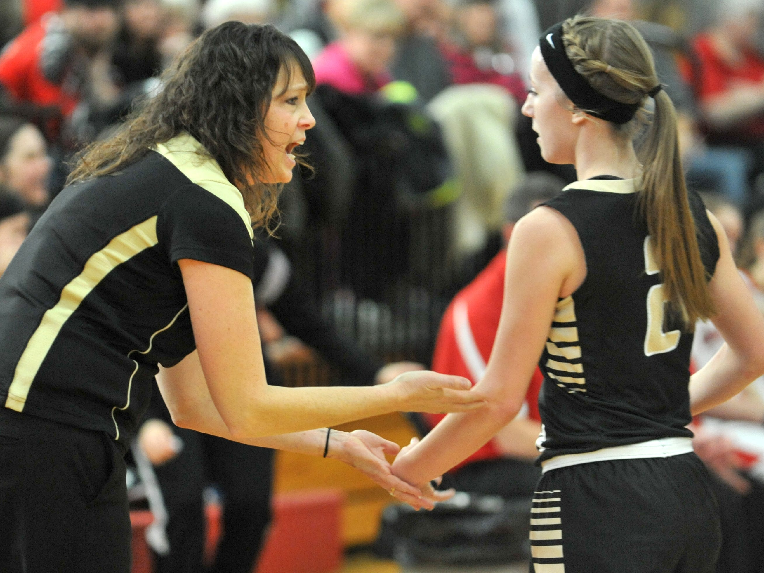 South Central girls basketball coach Becky Hintz talks to Asia Huffman during a break at Crestview earlier this year. Hintz resigned as head coach.