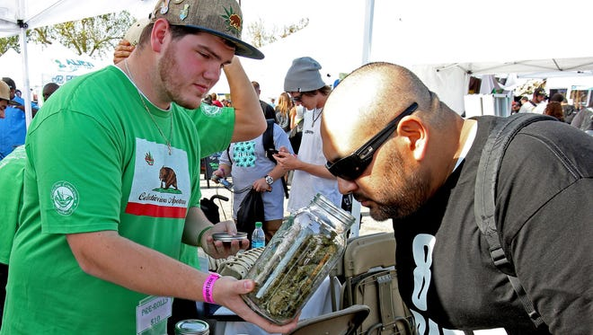 Will Cargal of Collective Conscious Apothecary lets customers smell the different types of weed at  the 'High Times' magazine sponsored Cannabis Cup event in San Bernardino, Calif.