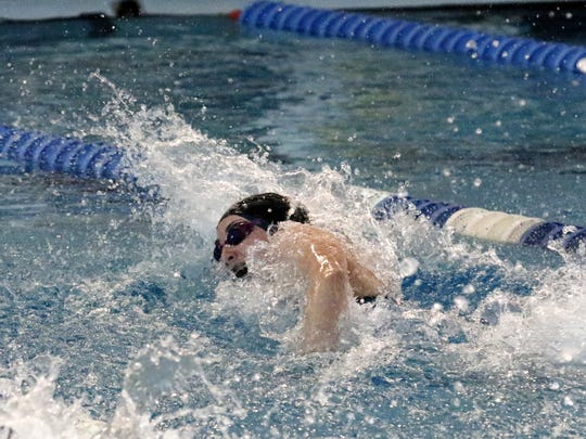 Katie Shoen of Owego Free Academy swims to a school record and qualfies ninth in the 50-yard freestyle Friday at the New York State Girls Swimming and Diving Championships at Ithaca College.