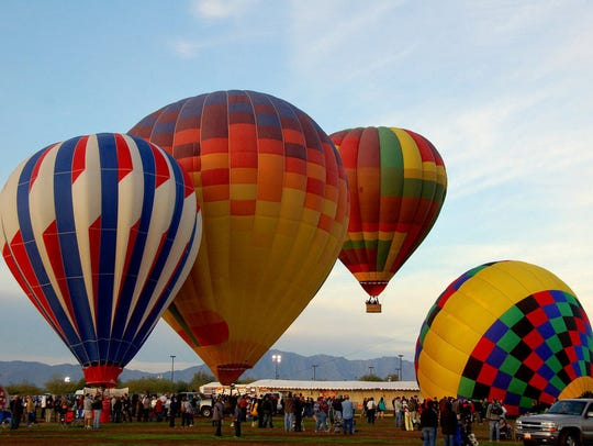 Kids can take a tethered hot air balloon ride during the three-day Arizona Balloon Classic.