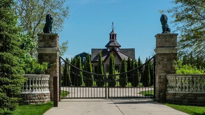 The front gate of the home of the Rev. Jonathan Wehrle in Williamston May 15, 2017. The priest is accused of embezzling more than $100,000.