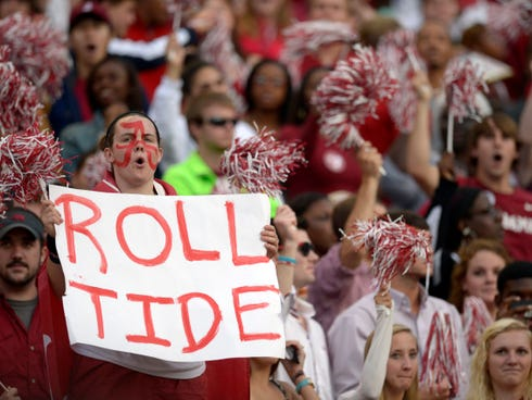 Oct 19, 2013; Tuscaloosa, AL, USA; Alabama Crimson Tide fans cheer prior to the start of their game against the Arkansas Razorbacks at Bryant-Denny Stadium. Mandatory Credit: John David Mercer-USA TODAY Sports