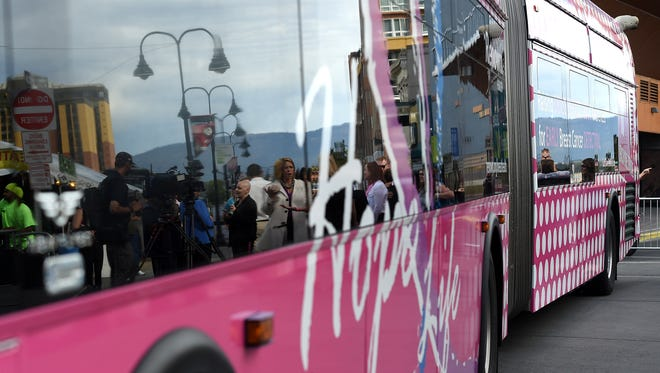 Media, dignitaries and survivors are seen during the unveiling of a wrapped RTC bus designed to raise awareness for dense breast tissue awareness and cancer detection on Virginia Street in downtown Reno on Sept. 24.