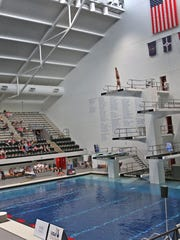Divers are dwarfed in the arena as they dive from the