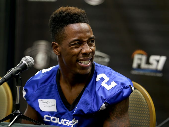 Jaylin Hayward of Godby answers a question during Tuesday's 2014 Media Day for regional high school football teams in the Big Bend region.