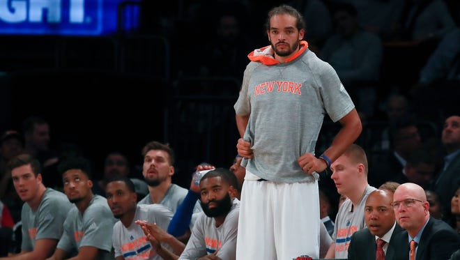 Joakim Noah of the New York Knicks looks on from the bench against the Boston Celtics during the second half of their preseason game at Madison Square Garden on October 15, 2016 in New York City.
