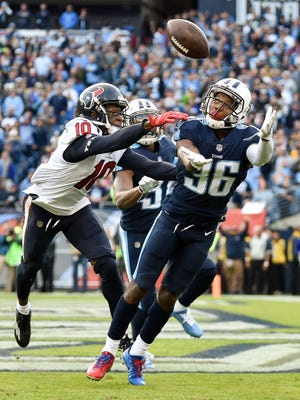 Titans cornerback LeShaun Sims (36) intercepts a pass intended for Texans wide receiver DeAndre Hopkins (10) during the second half at Nissan Stadium in Nashville, Tenn., Sunday, Dec. 3, 2017.