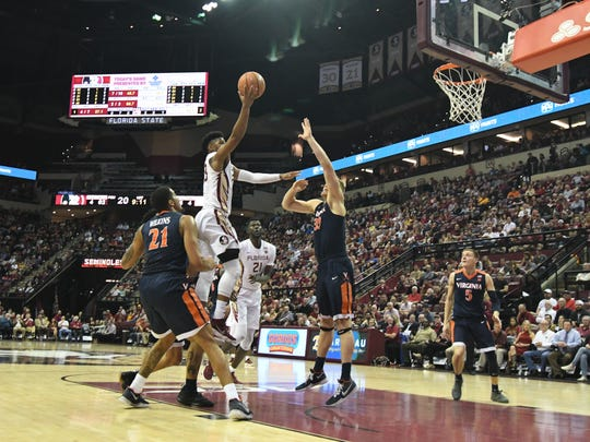 FSU freshman guard MJ Walker (23) shooting a layup during the first half.