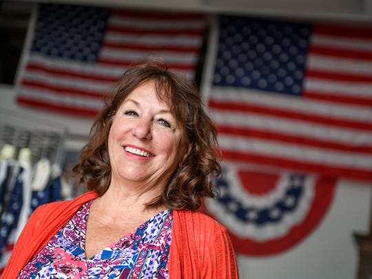 Store owner Jane Miles at American Flag and Banner,