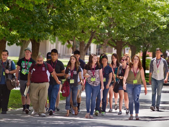 Groups of new NMSU students make their way around the