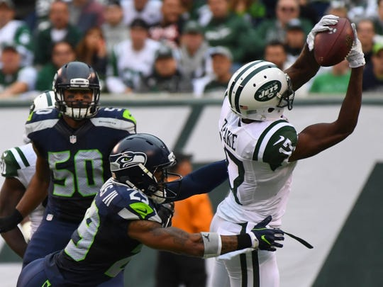 New York Jets wide receiver Charone Peake (17) makes a catch in front of Seattle Seahawks free safety Earl Thomas (29) during the second quarter at MetLife Stadium on Sunday.