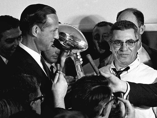 NFL commissioner Pete Rozelle, left, presents the trophy to Green Bay Packers coach Vince Lombardi after they beat the Kansas City Chiefs 35-10 in Super Bowl I in Los Angeles.