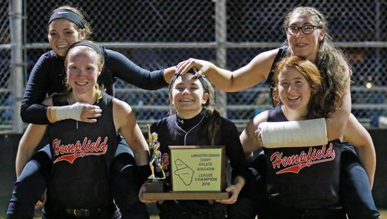 Hempfield senior's pose for a shot with the championship