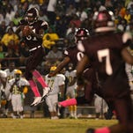 Booker T. Washington's Tre'Shawn Hill hauls in an interception against Green Oaks during the 2014 Soul Bowl. Hill returned the pick for a touchdown.