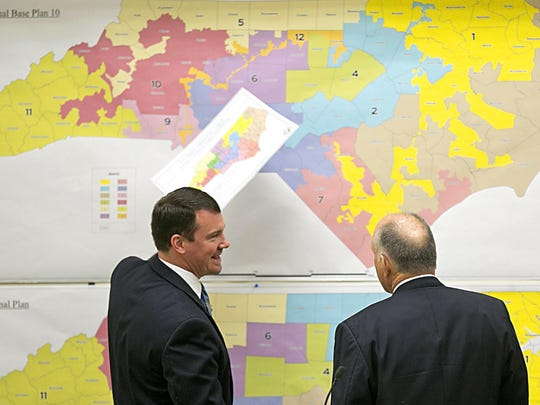 North Carolina Republican state Sens. Dan Soucek, left, and Brent Jackson review historical maps during the Senate Redistricting Committee in 2016.