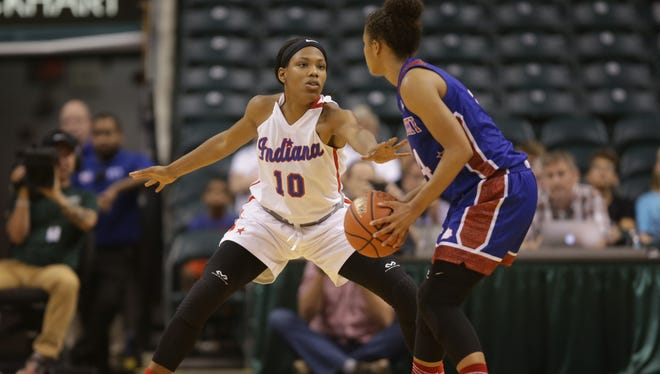 New Albany's Chyna Anthony (10) and Butler's Jaelynn Penn (4)  at the Indiana vs. Kentucky High School All-Star game at Bankers Life Fieldhouse in Indianapolis on Saturday, June 10, 2017.