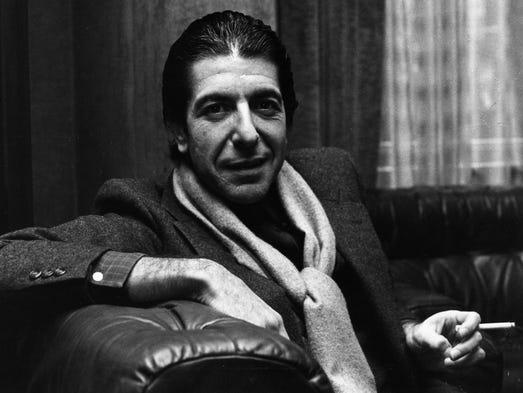 Leonard Cohen shares a joke and smokes a cigarette