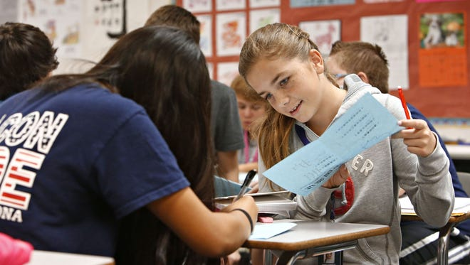 Meg Roberts,13,  practices writing her Mandarin during class at Sonoran Trails Middle School in the Cave Creek School District, on October 6, 2015.