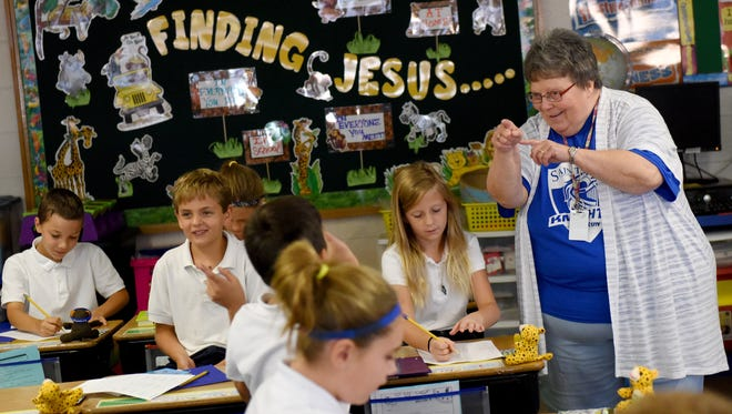 Jan McEntee, aka Miss Mac, teaches third graders at St. Mary Elementary School in Sioux Falls. This is her 49th year of teaching.