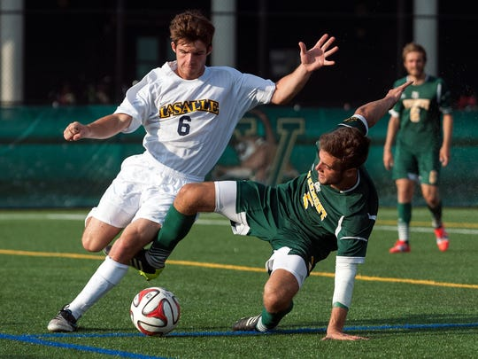 Vermont's Charlie Defeo (5) battles for the ball with La Salle's Matt Robinson (6) during a game at Virtue Field on Sept. 5, 2014, two weeks before DeFeo suffered a season-ending knee injury.