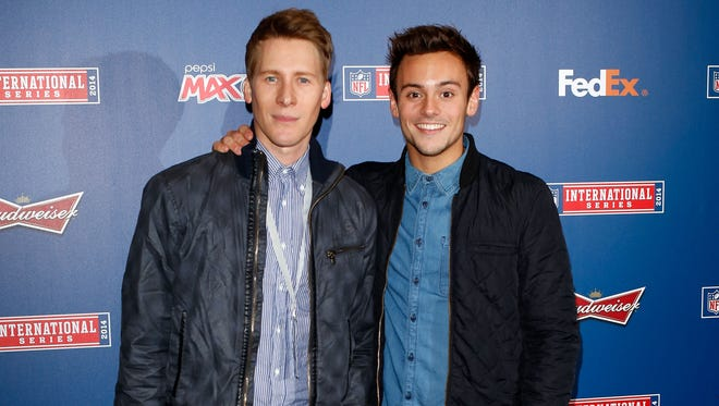 Dustin Lance Black and Tom Daley attend as the Dallas Cowboys play the Jacksonville Jaguars in an NFL match at Wembley Stadium on November 9, 2014 in London, England.