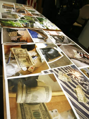 At a news conference in 2010, the Indianapolis Metropolitan Police Department displayed photographs of drug money and marijuana seized by its Criminal Interdiction Unit.