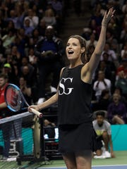 Savannah Guthrie waves during an exhibition tennis