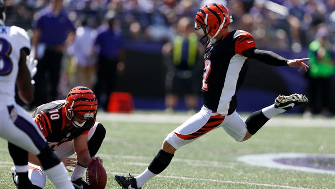 Bengals kicker Mike Nugent kicks a second-quarter 46-yard field goal against the Ravens on Sunday.