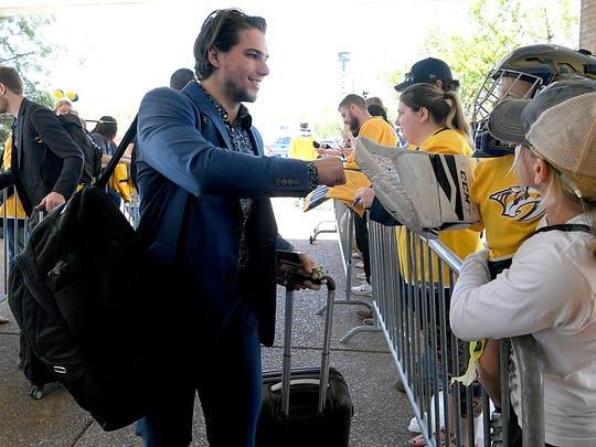 Predators left wing Kevin Fiala greets fans at Signature