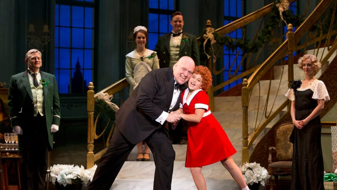 """Issie Swickle and Gilgamesh Taggett star as Annie and """"Daddy"""" Warbucks in the new tour of """"Annie"""" that opened Tuesday night at the Barbara B. Mann Performing Arts Hall."""