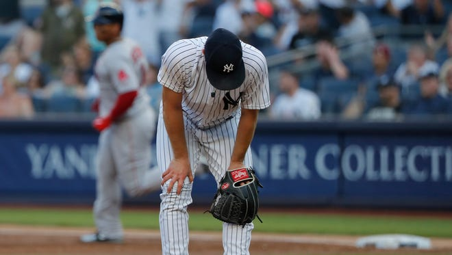 New York Yankees starting pitcher Sonny Gray reacts after giving up a grand slam to Boston Red Sox's Rafael Devers during the first inning of a baseball game, Saturday, June 30, 2018, in New York.
