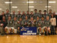 The Penfield boys volleyball team poses for with the