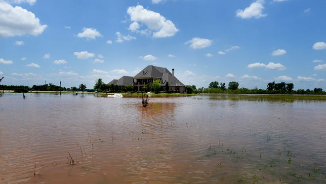 A house is surrounded by high water at River Bluff Subdivision in North Bossier.
