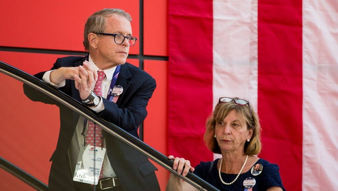 Ohio attorney general Mike DeWine and his wife, Fran, look at the crowd honoring Ohio Gov. John Kasich at the Rock and Roll Hall of Fame in Cleveland during the GOP convention in July 2016. DeWine is planning a likely bid to succeed Kasich as governor.