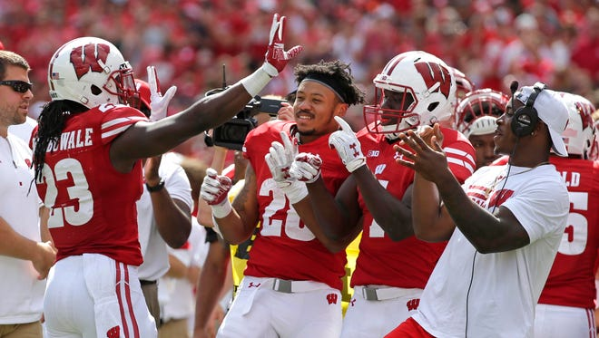 Wisconsin Badgers running back Dare Ogunbowale (23) celebrates his touchdown in the third quarter during Wisconsin's 23-17 win over Georgia State  during the NCAA football  game Saturday, September 17, 2016, at Camp Randall Stadium in Madison, Wis. Milwaukee Journal Sentinel photo by Rick Wood/RWOOD@JOURNALSENTINEL.COM ORG XMIT: 00089497A