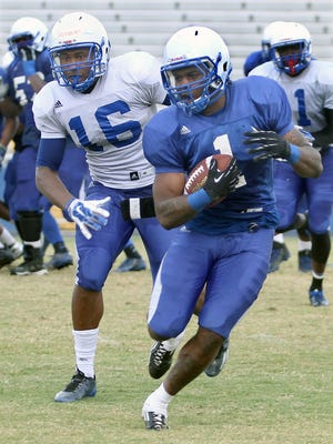 TSU's Tom Smith looks for some running room during Saturday's scrimmage.