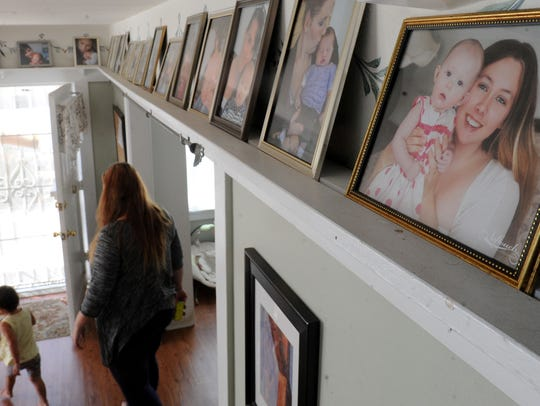 Amanda Gracey and her daughter Rylee Gracey, 1, walk through the living room at Tender Life Maternity Home in Ventura. The nonprofit offers housing to homeless pregnant women.Gracey is six months' pregnant.