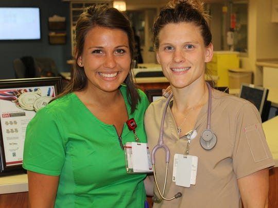 Courtney Donlon (left) of East Brunswick, a nurse at Robert Wood University Hospital in New Brunswick, helped save the life of a fellow JetBlue passenger on a flight Monday. Here with her sister, Nicolle Black, Donlon comes from family of nurses. She, her sister and mother work at RWJUH.