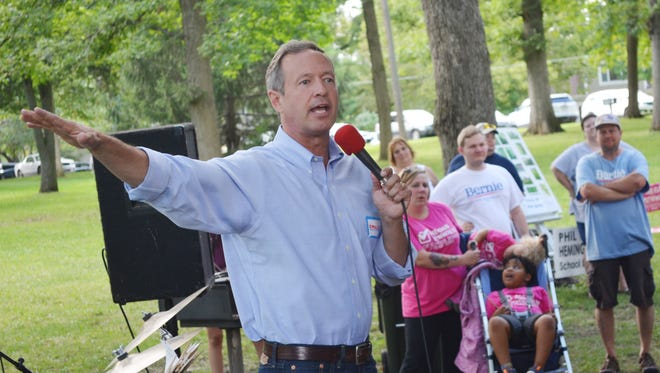 Former Maryland Gov. Martin O'Malley, a Democratic presidential candidate, speaks to a crowd Monday at the annual Labor Day picnic in City Park in Iowa City.
