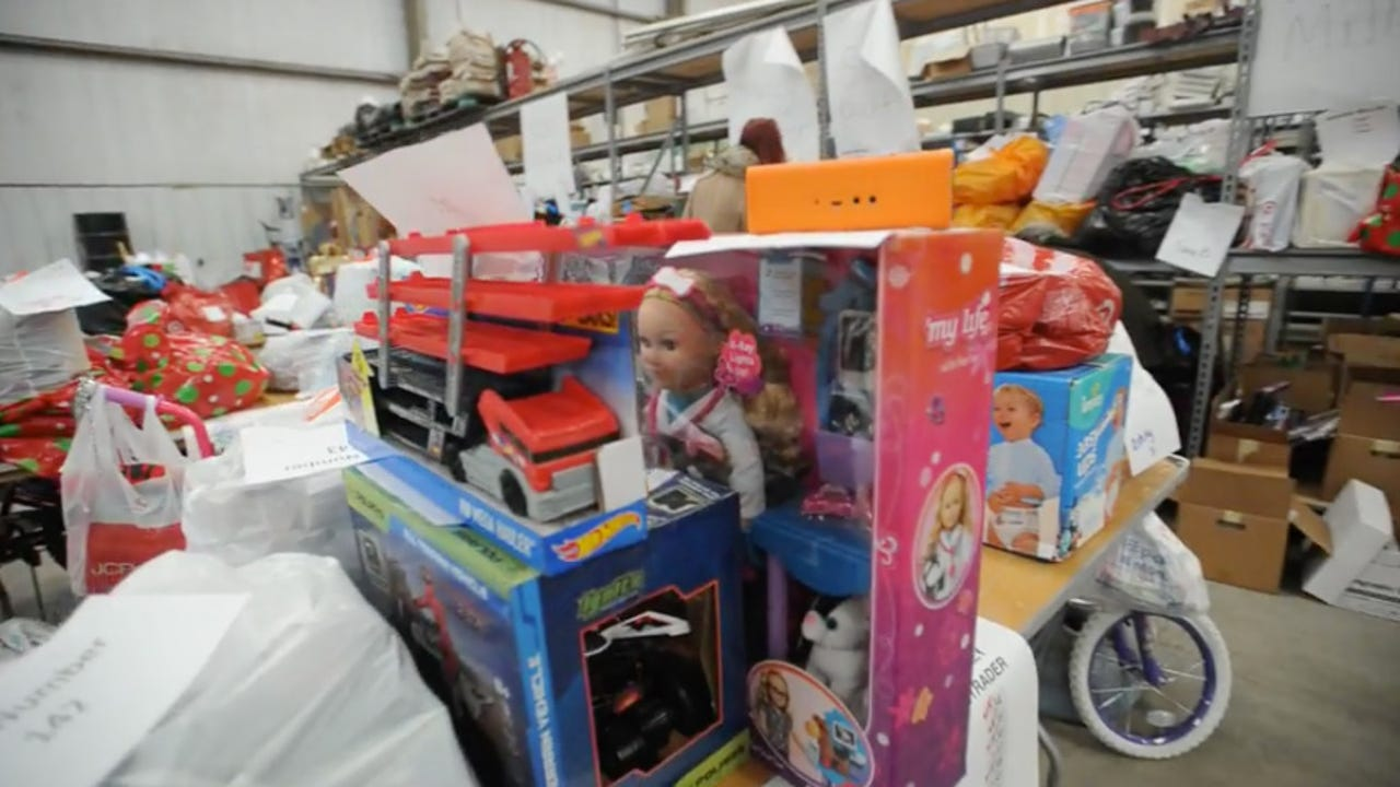 Volunteers organize Christmas gift donations collected by the Taylor County Child Welfare Board to serve 290 abused or neglected children in their program.