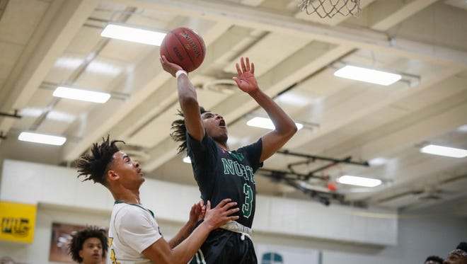 Des Moines North junior point guard Tyreke Locure runs up a shot against Des Moines Hoover on Tuesday, Jan. 9, 2018, at Hoover High School in Des Moines.