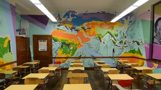 This mural for Covington Independent Schools is included in a documentation of more than 50 murals created by Higher Level Art for the school district. The documentation will be exhibited at The Carnegie Sept. 11-Nov. 21.