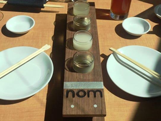 FRIDAY: Saki Display at Nom Sushi Izakaya.