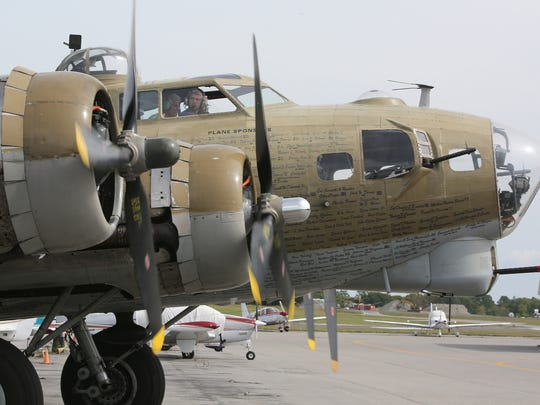 A WWII B-17 bomber lands on the tarmac at the Westchester County Airport. The legendary plane is part of the Wings of Freedom tour.